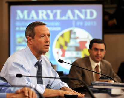 Maryland Gov. Martin O'Malley briefs reporters Wednesday on his Fiscal Year 2013 budget. In background right is Joshua M. Sharfstein, secretary, Department of Health and Mental Hygiene.