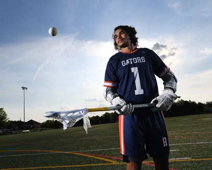 Reservoir senior midfielder Jakota Parker, who is an all-around contributor for the undefeated Gators, is photographed after a boys lacrosse practice at Reservoir High School in Fulton on Monday, May 17, 2021.