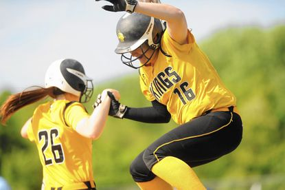Clarksville, Md. 5/15/15 Staff Photo by Brian Krista Mt. Hebron's Evvie Buehlman, right, celebrates driving in a pair of runs with teammate Rylee Kinsella during the regional championship softball game at River Hill High School on Friday, May 15.