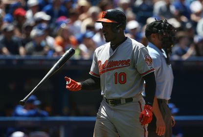 Adam Jones of the Orioles reacts after striking out in the fourth inning against the Toronto Blue Jays on June 20, 2015 at Rogers Centre in Toronto.