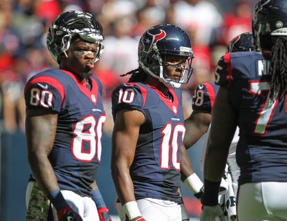 Texans wide receiver Andre Johnson (80) and wide receiver DeAndre Hopkins (10) relax before their Nov. 23 game against the Bengals at NRG Stadium.
