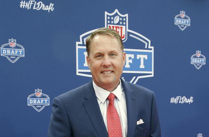 """Mississippi coach Hugh Freeze poses for photos upon arriving for the first round of the 2016 NFL football draft in Chicago. Freeze was surprised by former Rebels offensive lineman Laremy Tunsil's statement at the NFL draft that he accepted money from a coach while at the school. Freeze said Thursday, May 5, 2016, on an SEC teleconference he is not involved in the """"fact-finding process"""" but has been told that the school has """"made a lot of progress"""" in the investigation."""