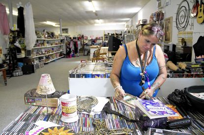 Cheryl Dabrasky, 48, sorts through items to be sold at her Arbutus consignment shop on East Drive.