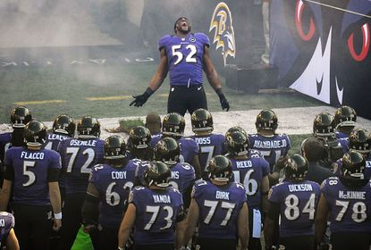 Ray Lewis dances his way out of the tunnel before the game.