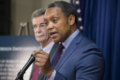 District of Columbia Attorney General Karl Racine, right and Maryland Attorney General Brian Frosh announce their lawsuit against President Donald J. Trump last year. They claim foreign payments to Trump's businesses violate the Constitution's Emoluments Clause.