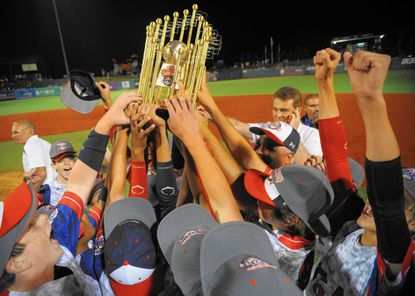 MLB Commissioner Rob Manfred is expected to visit the Cal Ripken World Series in Aberdeen, which begins play on July 24. Above, players, coaches and fans from West Raleigh, N.C., hoist the 2014 championship trophy.