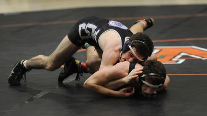 Mount Saint Joseph160 pound wrestler Neil Schuster (top) pinned Ryan Warshaw to win the match on Jan. 20, 2016. Mount St. Joe is ranked first in boy boys basketball and wrestling in the Sun's Feb. 8 polls.