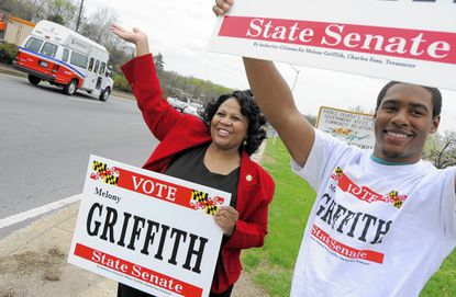 Delegate Melony Griffith (left) and Quentin Walker a supporter waving to potential voters at the intersection of Central Ave and Addison Road.