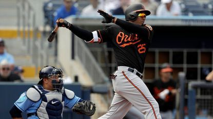 Baltimore Orioles' Anthony Santander (25) lines a two-run single off Tampa Bay Rays pitcher Yonny Chirinos in the fifth inning of a spring training baseball game Wednesday, March 7, 2018, in Port Charlotte, Fla. Orioles' Jonathan Schoop and Danny Valencia both scored.