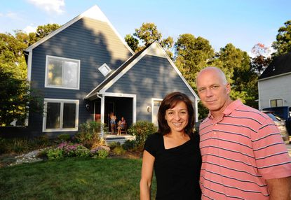 Dennis and Linda-Lou O'Connor are pictured in front of their new home with daughters Casey, 13, and Kiley, 11.