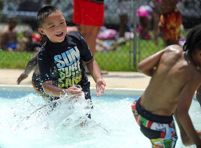 Lucas Cao, 6, splashes in the kiddie pool at the Westminster Municipal Pool Tuesday, June 17.