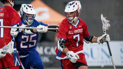 """Attackman Cole """"Bubba"""" Fairman advances the ball for the South during the Under Armour All-America Boys Lacrosse Game at Johnny Unitas Stadium at Towson University on July 1, 2017."""