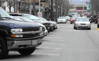 Cars are parked along The Avenue in Hampden