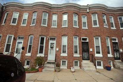 Freddie Gray, who died from injuries while in police custody, was raised with his sisters in this rowhouse. They filed a lawsuit alleging lead paint poisoning.