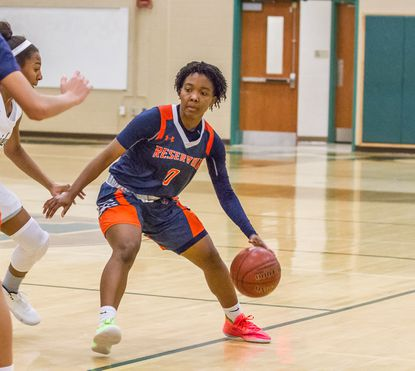 Reservoir's Tiffany Hooker dribbles as Atholton's Mia Hargrett defends. Hooker scored 34 points in the Gators' 68-56 win over the Raiders on Friday, Jan. 24, 2020.