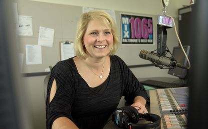 DJ Maria Dennis is pictured in August 2016 in the studio at Mix 106.5 FM, Baltimore's CBS affiliate and Top 40 station. She was diagnosed with leukemia in 2014.