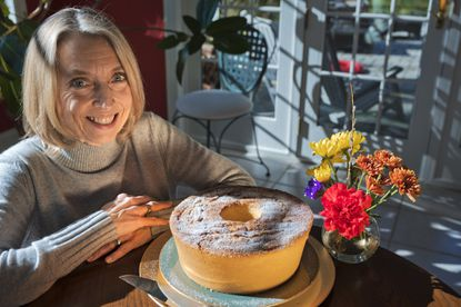 Cara Ehrlich poses with her baked dessert, from her mother's pound cake recipe, to raise awareness of the estimated 5.8 million Americans still living with Alzheimer's.