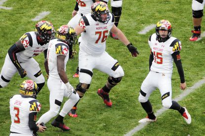 Maryland place kicker Brad Craddock (15) celebrates with teammates after kicking a 43-yard, game-winning field goal with 51 seconds left in the second half of an NCAA college football game against Penn State in State College, Pa., Saturday, Nov. 1, 2014. Maryland won 20-19. (AP Photo/Gene J. Puskar) ** Usable by LA, DC, CGT and CCT Only **