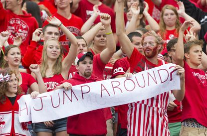 "Wisconsin fans partake in the traditional ""Jump Around"" celebration between the third and fourth quarters at Camp Randall Stadium, which has been known to shake the venue."