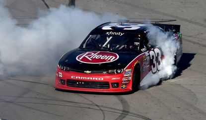 Austin Dillon, driver of the No. 33 Rheem Chevrolet, celebrates with a burnout after winning the NASCAR Xfinity Series Boyd Gaming 300 at Las Vegas Motor Speedway on Saturday.