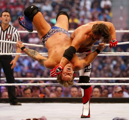 AJ Styles, right, wrestles with Chris Jericho during WrestleMania 32 at AT&T Stadium in Arlington, Texas, Sunday, April 3, 2016.