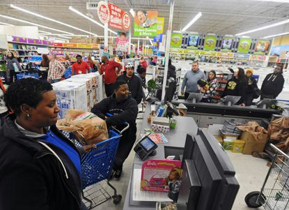 Shoppers wait for the 5 a.m. tablet computer door buster deal at the Toys R Us store in Glen Burnie on Black Friday.