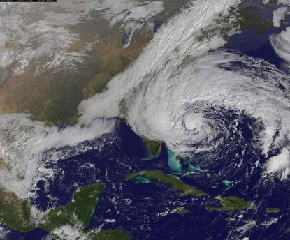 Hurricane Sandy is seen moving up towards the east coast of the United States in this NASA handout satellite image taken Saturday.