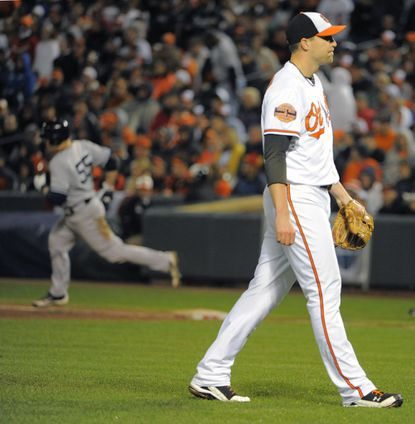 Orioles closer Jim Johnson reacts as Russell Martin rounds the bases following his ninth-inning home run Sunday night.