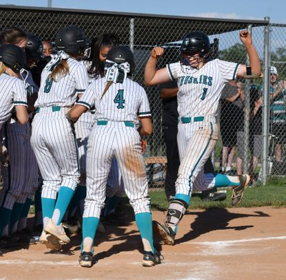 Teammates wait excitedly at the plate as Patterson Mill's Madison Knight comes home after her garnd slam homerun to end the game in the state semi-final game against Clear Spring Wednesday, June 16 2021 at Patterson MIll.