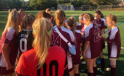 The Towson girls soccer team huddles together at halftime of their game against Hereford on Tuesday, Sept. 24.