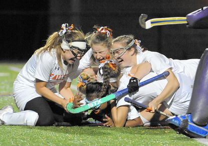 From left, Fallston's Maddie Hurlbert, Kylie Ryan and Becky Street pile on Liz Hebert after Hebert scored the game winning goal in overtime, as the Cougars beat Pocomoke to advance to the state title game.