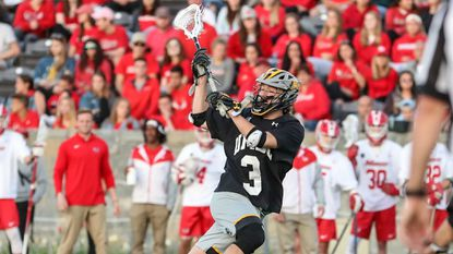 UMBC Junior Pat Clipp controls the ball in an NCAA play-in game against Marist on Wednesday night.