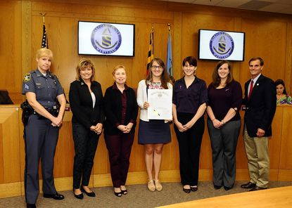 Pictured, from left, are Tracy Penman, Harford County Sheriff's Office; Sandi Linkous, SARC president of the board of directors; Hazel Hopkins, SARC volunteer; Kelsey Luchey, community relations coordinator; Liz Stoner, community outreach coordinator; Stephanie Powers, clinical director; and Billy Boniface, president of the Harford County Council, with a proclamation announcing October as Domestic Violence Awareness Month.