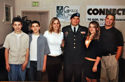 Peggy and Robert J. Marchanti, center with their four children, in an undated photo. From left, the children are twins Ian and Jonah, daughter Leah, and eldest son Aaron. Maj. Robert J. Marchanti II was killed in Afghanistan in February 2012.
