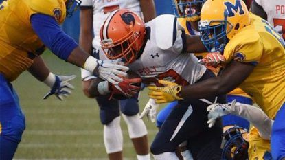In a game against Mervo on Sept. 15, Poly's Steven Sutton runs the ball in the second quarter.