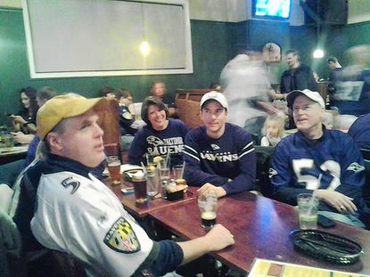 Bel Air town commissioners Dave Carey, left, and Rob Reier, second from right, were among the crowd at MaGerk's watching the AFC Championship game Sunday.