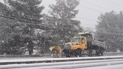 A SHA snow plow works as a heavy snow begins to fall Wednesday morning.