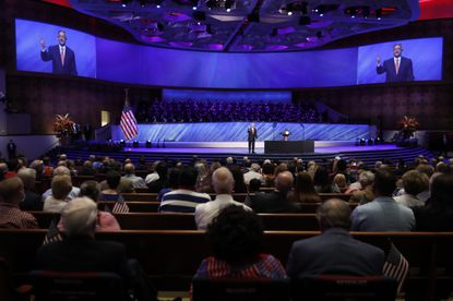 """In this Sunday, June 28, 2020 file photo, Senior Pastor Robert Jeffress addresses attendees before Vice President Mike Pence was to speak at the First Baptist Church Dallas during a Celebrate Freedom Rally in Dallas. Concerning the COVID-19 pandemic, the prominent megachurch leader has said, """"If we wanted to have zero risks, the safest thing would be to never open our doors. ... The question is how can you balance risk with the very real need to worship."""" (AP Photo/Tony Gutierrez)"""