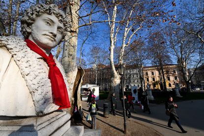 The statue of Italian Croatian-born painter Andrija Medulic, also known as Andrea Schiavone or Andrea Lo Schiavone, is pictured with a red tie knotted around the neck symbolizing Croatia's taking over the European Union's rotating presidency of the EU Council in central Zagreb on January 3.