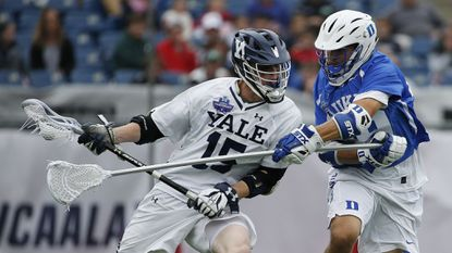 The 2018 NCAA champion Yale men's lacrosse may rely heavily on sophomore attackman Jackson Morrill (left) to overcome the graduation of attackman and Tewaaraton Award winner Ben Reeves in 2019. (AP Photo/Michael Dwyer)