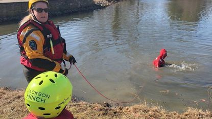 Assistant Chief Rhonda Hinch of the Level Volunteer Fire Company takes part in a cold-water rescue training exercise at a Churchville pond Saturday. Her son, Capt. Clinton Polk, is in the water as a victim, and her grandson, Jackson Hinch, assists.