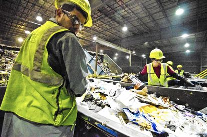 (photo by noah scialom)B581852590Z.1dow}, January 27, 2012 Two years after it opened, Baltimore County's single stream recycling program and its workers sort nearly 1,000 tons of recycling everyday.