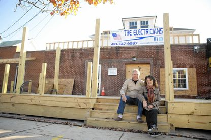 Jim and Sharon Andrews sit outside of their new restaurant, Oak Creek Cafe, on East Drive in Arbutus. The former site of Leon's Triple L Restaurant is currently under construction and is scheduled to open Dec. 12.