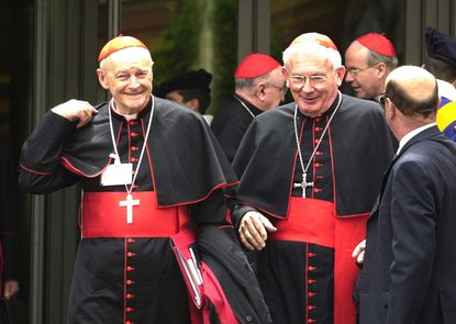 In this May 21, 2001 file photo, Cardinals William Henry Keeler, right, Archbishop of Baltimore, and Theodore Edgar McCarrick, Archbishop of Washington, D.C., leave a major meeting with cardinals from around the world attended by Pope John Paul II in the Synod Hall at the Vatican. (AP Photo/ Massimo Sambucetti, File)