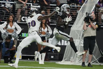 Las Vegas Raiders defensive end Maxx Crosby (98) catches a pass against Baltimore Ravens cornerback Chris Westry (30) during overtime in an NFL football game, Monday, Sept. 13, 2021, in Las Vegas. (AP Photo/Rick Scuteri)