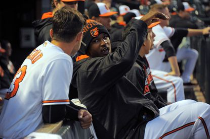 Orioles center fielder Adam Jones (facing camera), out with an injury, speaks withJoey Rickard who started in centeragainst the Minnesota Twins at Camden Yards on April 7, 2016.