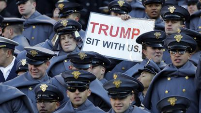 An Army cadet displays a sign for then President-elect Donald Trump in the first half of the Army-Navy game at M&T Bank Stadium in 2016.