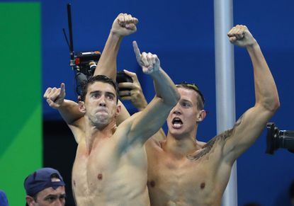 Michael Phelps of United States celebrates during the men's 4x100-meter freestyle relay during Day 2 of the Rio 2016 Olympic Games at Olympic Aquatics Stadium on August 7, 2016 in Rio de Janeiro.