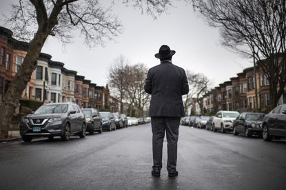 A Hasidic man stands where he was attacked last year in the Crown Heights section of Brooklyn, on Feb. 10, 2020. Jewish people were the victims in more than half of the hate crimes in New York City last year, with many of the crimes committed in heavily Orthodox neighborhoods, according to the Police Department.