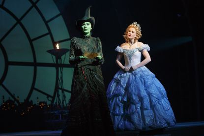 Alyssa Fox, left, as Elphaba and Carrie St. Louis, right, as Glinda in 'Wicked,' playing at the Hippodrome.